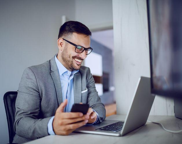 man smart suit glasses laptop